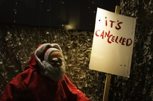 Santa holding sign saying it's cancelled